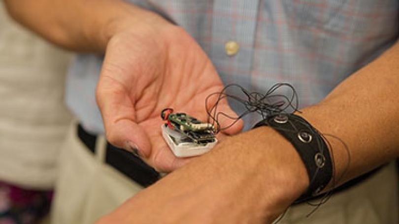 Professor David Kotz tests the prototype bioimpedance biometric bracelet.